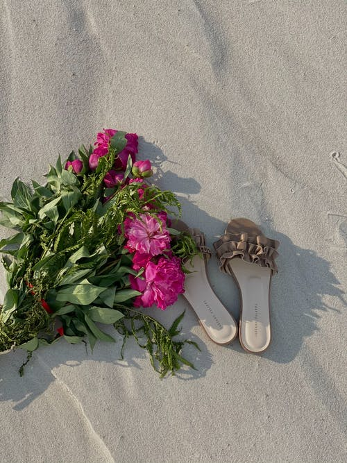 Pink and White Flowers on White Flip Flops