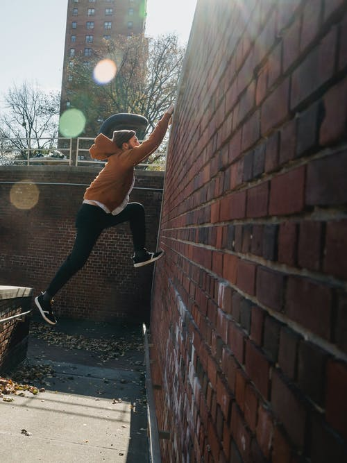 Sportive man doing parkour on street