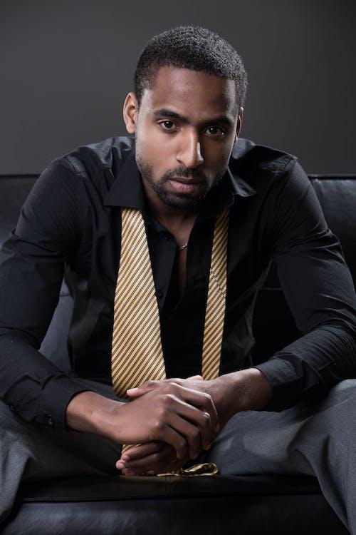 Man in Black Dress Shirt and Yellow Necktie