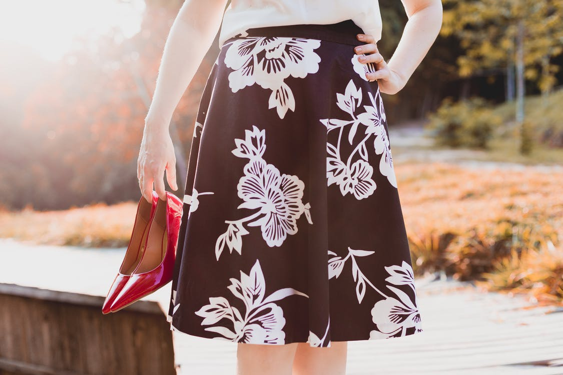 Woman Wearing Skirt Holding Her Shoes