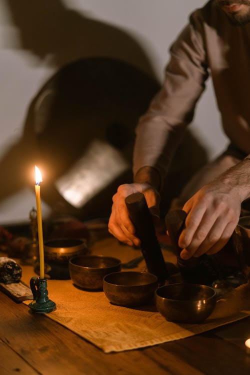 Person Holding Black Candle Holder