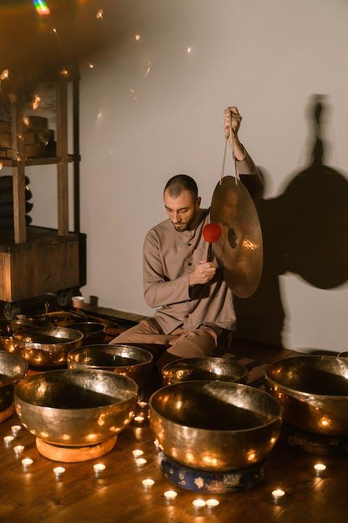 Man in Gray Dress Shirt Playing Drum