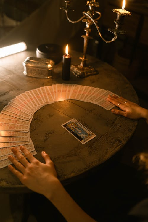 Person Holding Brown Round Table