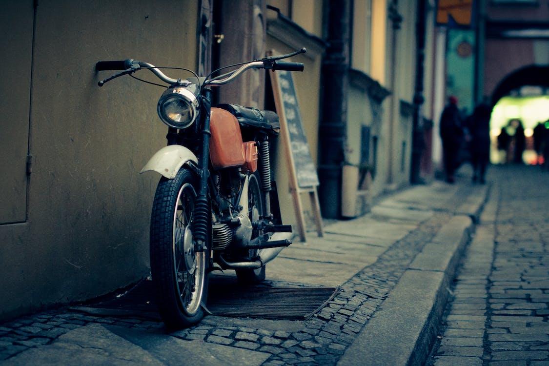 Black Orange Silver and White Motorcycle