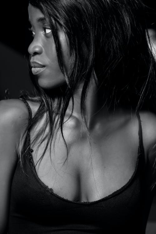Black woman in dark provocative top