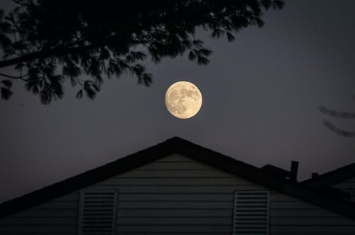 White and Black House Under Full Moon