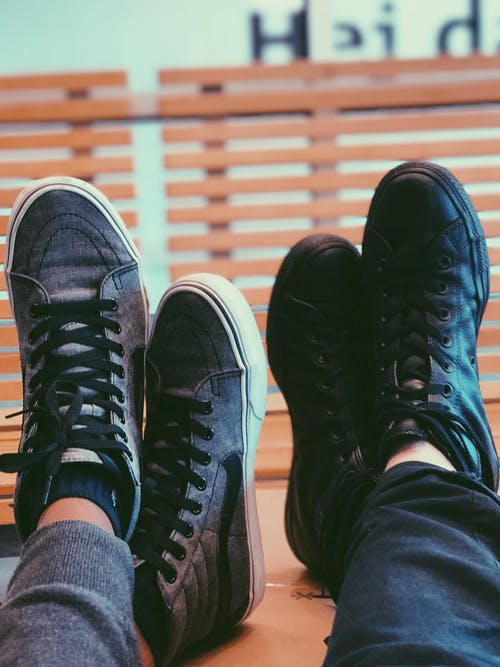 Two People Wearing Black Sneakers