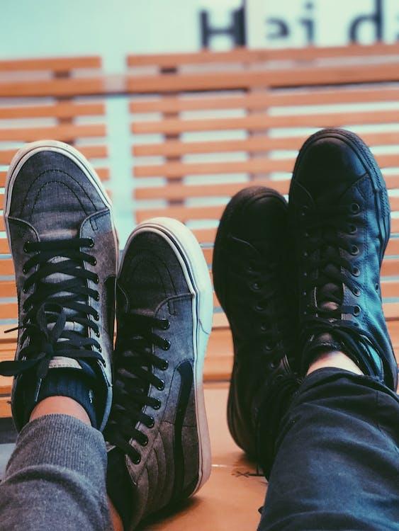 Two People Wearing Black Sneakers