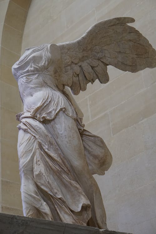 Angel Statue on White Wall