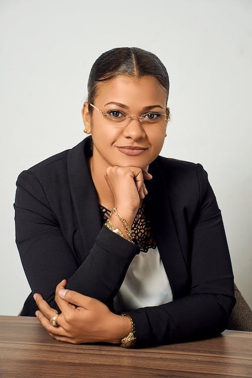 Woman in Black Blazer and Silver Framed Eyeglasses