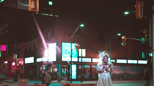 Person Wearing White Dress Near Traffic Light