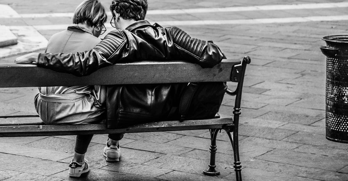 Grayscale Photo Of Two Person Sitting On A Bench 183 Free