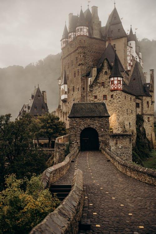 Brown Brick Castle Under Cloudy Sky