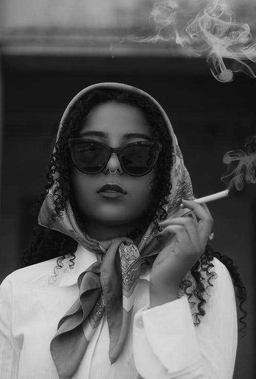Grayscale Photo of Woman Wearing Sunglasses and White Long Sleeve Shirt