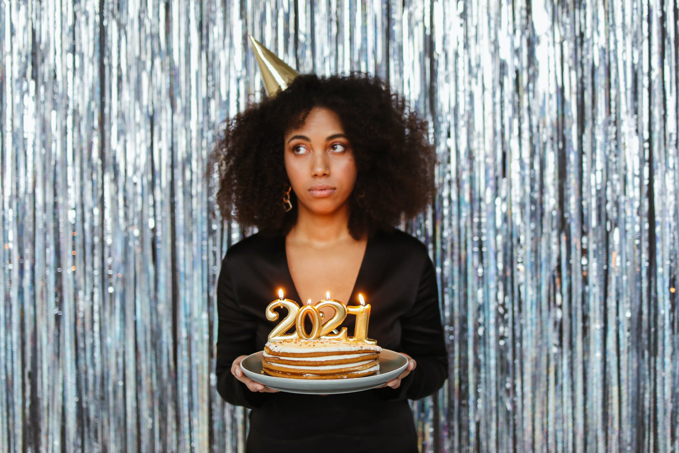 Woman holding 2021 New Year cake