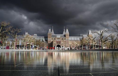 Kostenloses Stock Foto zu amsterdam, architektur, dunkle wolken, himmel
