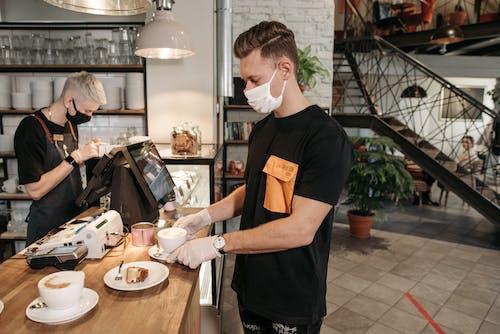 Man in Black Crew Neck T-shirt Holding White Ceramic Plate