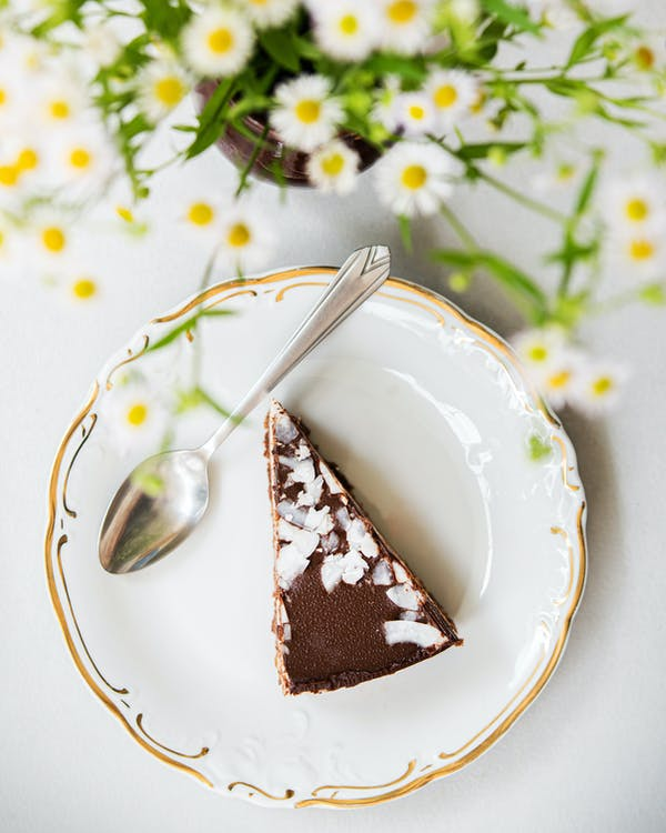 Photo Of Sliced Cake On A Ceramic Plate