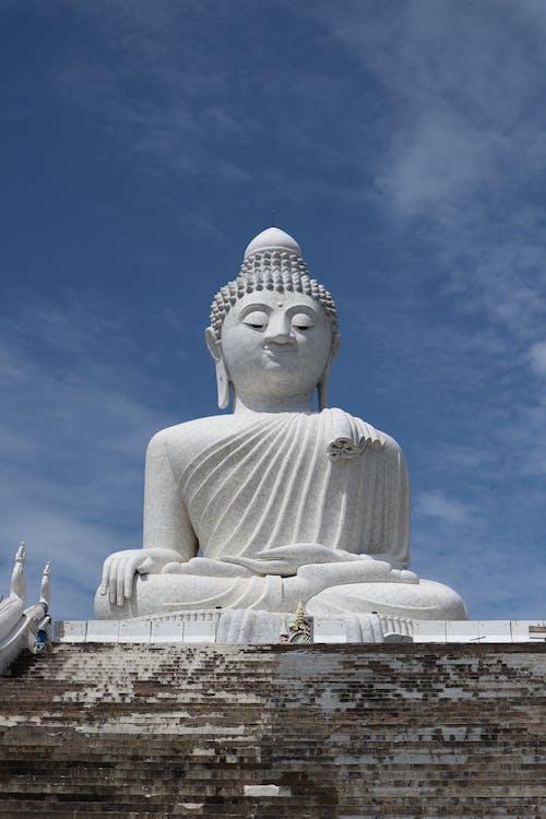White Concrete Buddha Statue Under Blue Sky