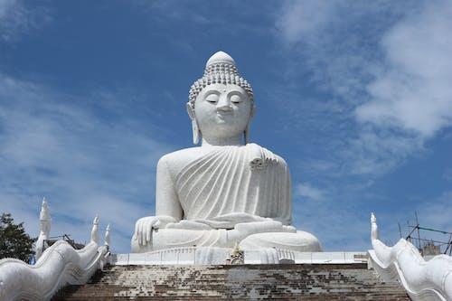White Concrete Statue Under Blue Sky