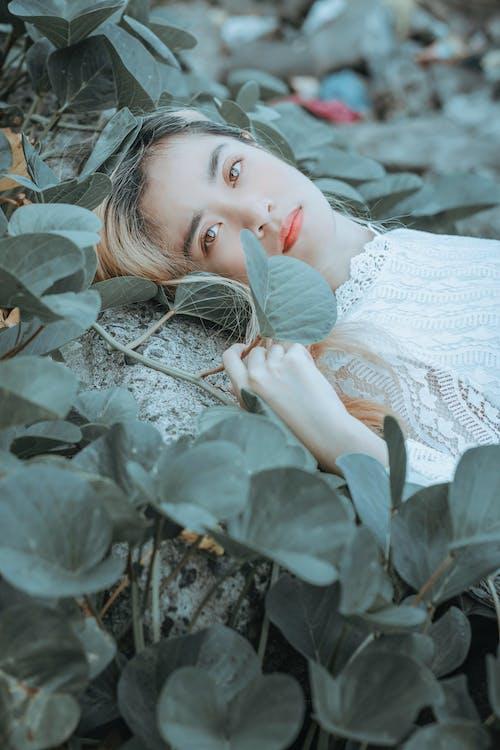 Charming woman amidst green plants