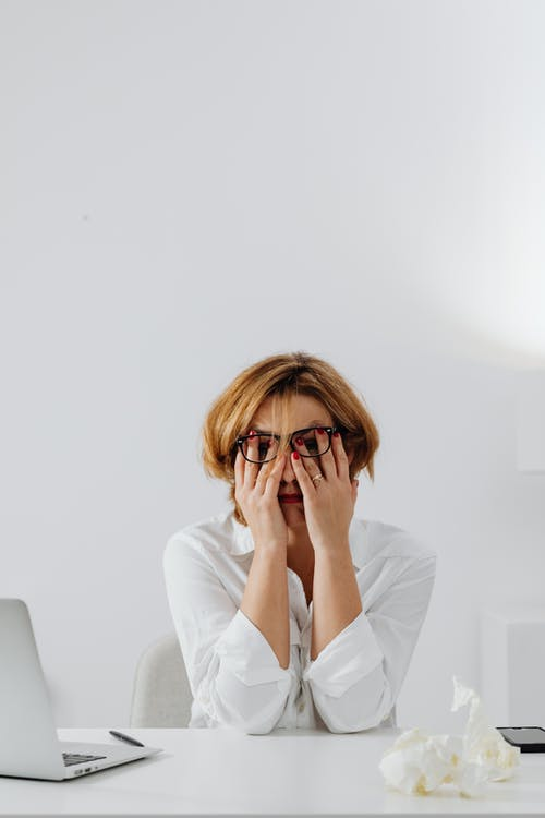 Woman in White Dress Shirt Wearing Brown Framed Eyeglasses