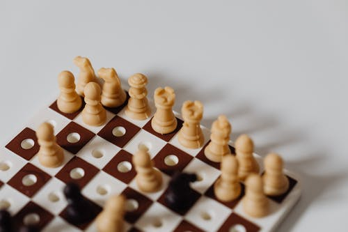 Close Up Photo of a Miniature Chess Toy