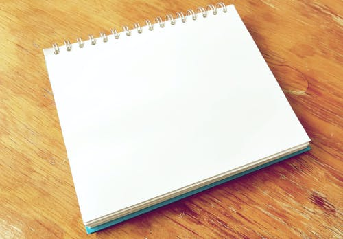 White Notepad on Brown Surface