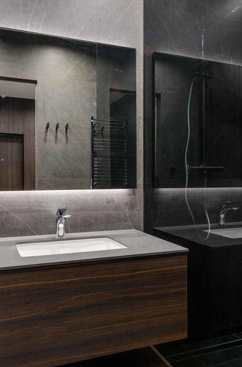 Stylish bathroom with glass elements in apartment