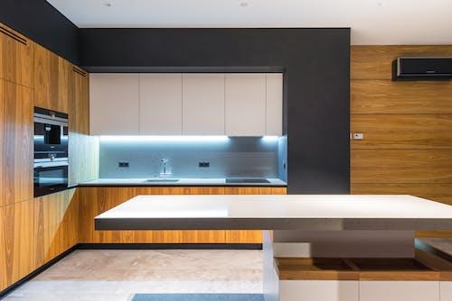 Stylish kitchen with illuminated cooking zone