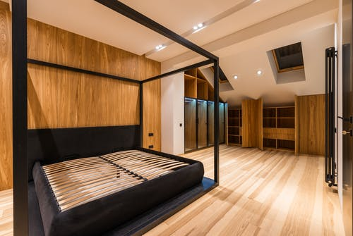 Empty bedroom with modern wooden furniture