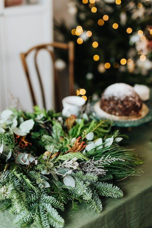 Christmas Wreath and Cake on a Table