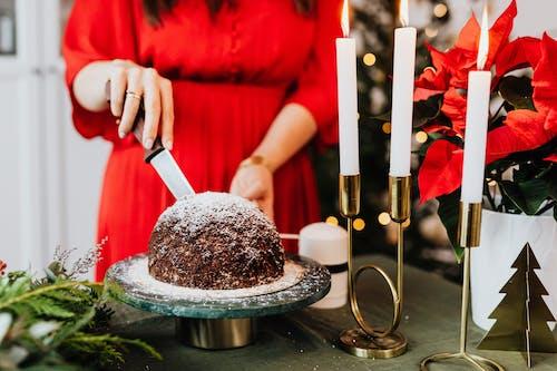 Woman Cutting a Chocolate Cake