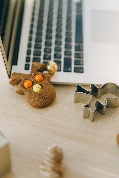 Brown Bear Figurine on Brown Wooden Table