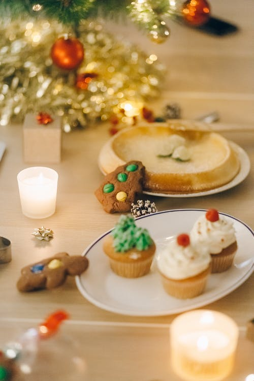 Selective Focus of Delicious Cookies and Cupcakes on a Plate