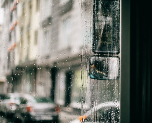 Wet windscreen of bus in rainy day