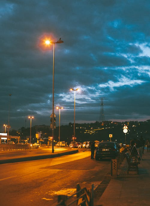 Road with streetlamps at night