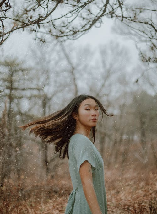 Young slim Asian woman with long flying hair