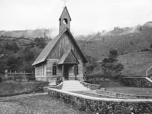Grayscale Photo of Church Near River