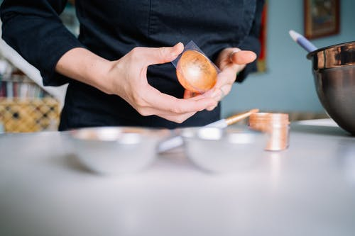 Person Holding Brown Round Fruit