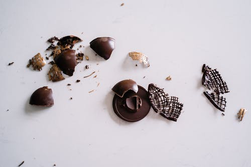 Photo Of Smashed Chocolate On A White Background