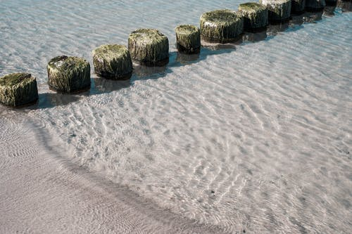 Gray Rocks on White Sand