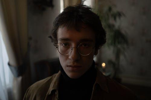 Man in Black Framed Eyeglasses and Brown Jacket