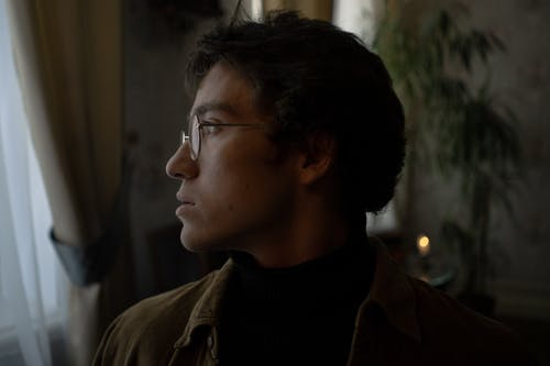 Man in Brown Jacket Wearing Eyeglasses