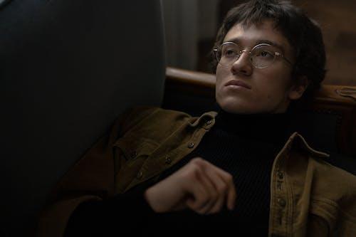 Woman in Brown Jacket Wearing Eyeglasses