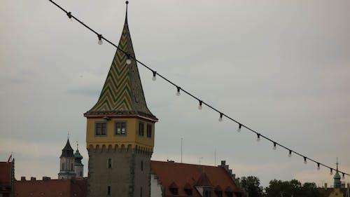 Foto d'estoc gratuïta de ennuvolat, fons, poble, torre