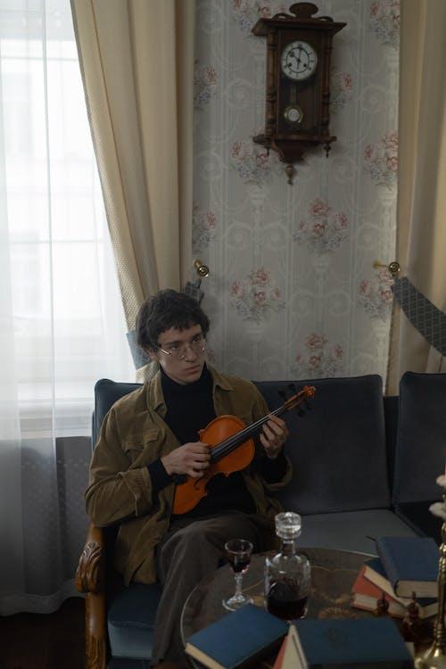 Woman in Brown Coat Playing Violin