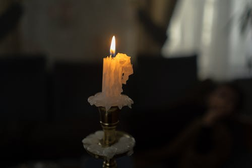 White Candle on Brass Candle Holder