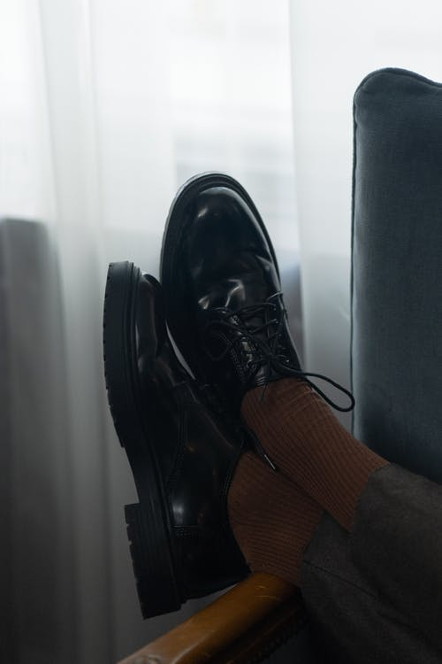 Person Wearing Black Leather Lace Up Shoe