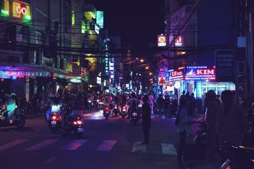 Crowded city street at night in Asian country